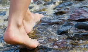 Stepping into river