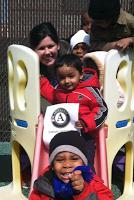 Sarah C with kids on slide IMG_0426